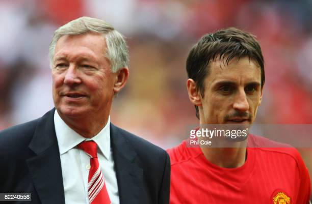 Sir Alex Ferguson manager of Manchester United and captain Gary Neville look on prior to the FA Community Shield match between Manchester United and...