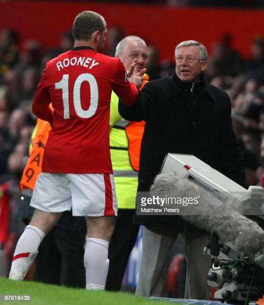 Sir Alex Ferguson manager of Manchester United congratulates Wayne Rooney after he was substituted during the UEFA Champions League First Knockout...