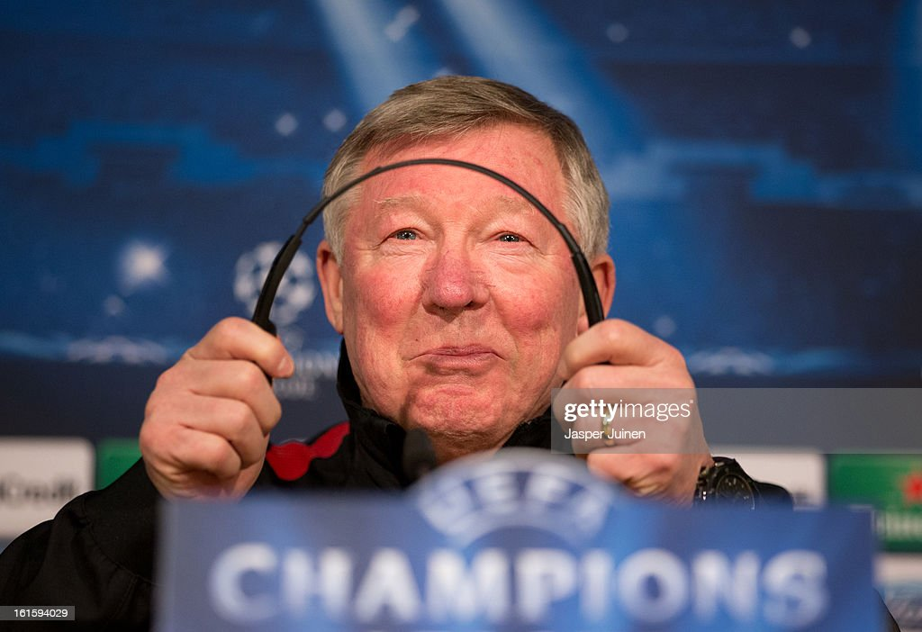 Sir Alex Ferguson, manager of Manchester United, jokes while holding his headphones during a press conference ahead of the UEFA Champions League match between Real Madrid CF and Manchester United at the Valdebebas training ground on February 12, 2013 in Madrid, Spain.