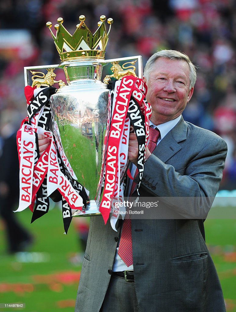 Sir Alex Ferguson manager of Manchester United lifts the Premier League trophy after the Barclays Premier League match between Manchester United and Blackpool at Old Trafford on May 22, 2011 in Manchester, England. Manchester United celebrate a record 19th league championship.