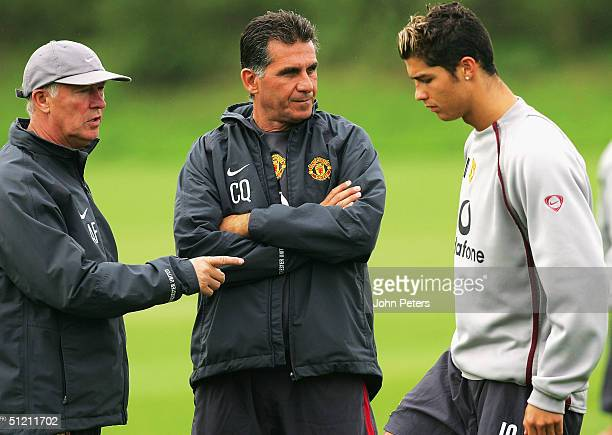Sir Alex Ferguson of Manchester United and assistant manager Carlos Queiroz talk to Cristiano Ronaldo during a first team training session ahead of...