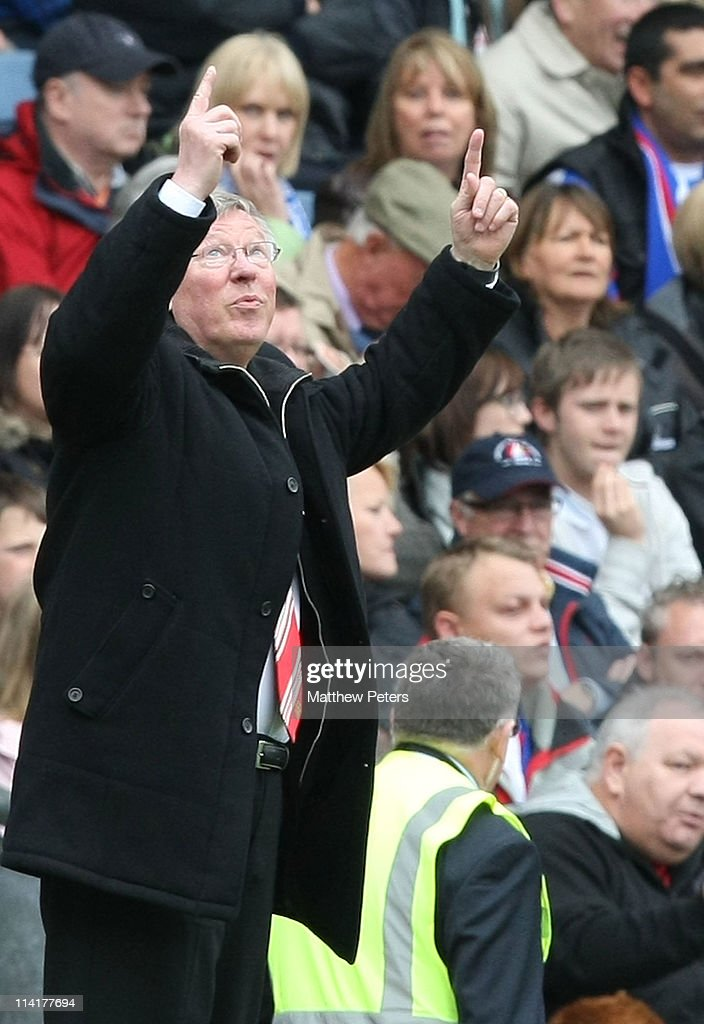 Sir Alex Ferguson of Manchester United celebrates winning the Premier League title after the Barclays Premier League match between Blackburn Rovers and Manchester United at Ewood Park on May 14, 2011 in Blackburn, England.