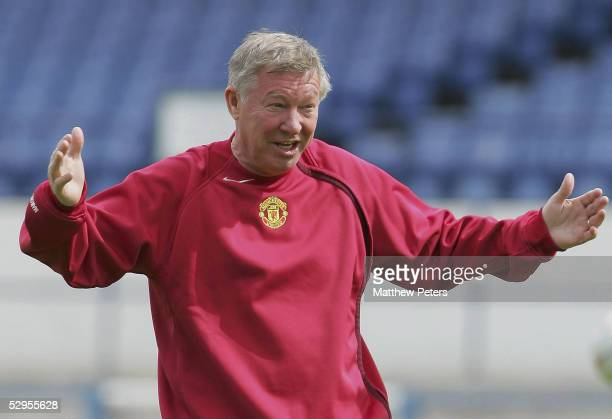 Sir Alex Ferguson of Manchester United in action during a training session ahead of the FA Cup Final at Ninian Park on May 20 2005 in Cardiff Wales