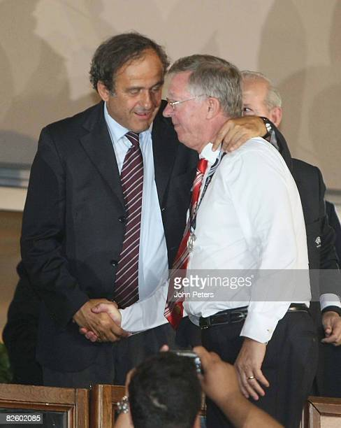 Sir Alex Ferguson of Manchester United is consoled by Michel Platini after the UEFA Supercup match between Manchester United and Zenit St Petersburg...