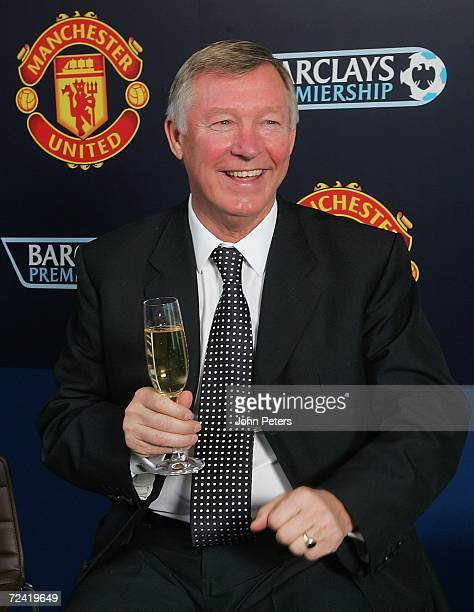 Sir Alex Ferguson of Manchester United poses with a glass of champagne at the lunch to celebrate the 20th anniversary of his arrival at Old Trafford...