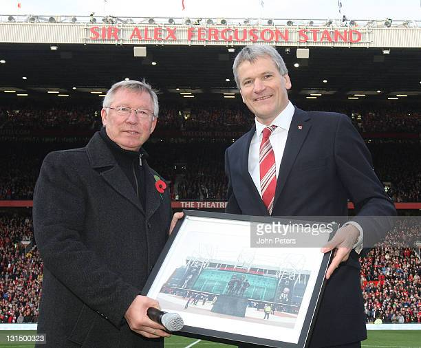 Sir Alex Ferguson of Manchester United poses with Chief Executive David Gill after it was announced that the North Stand of Old Trafford would be...