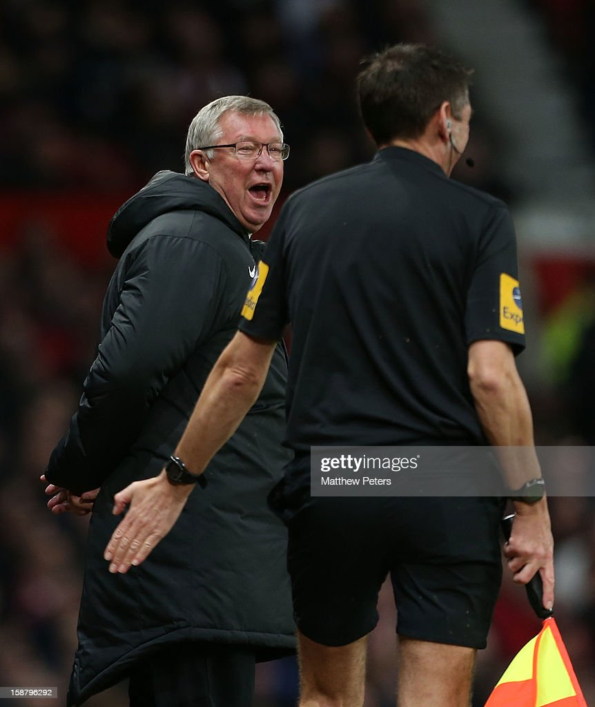 Sir <a gi-track='captionPersonalityLinkClicked' href=/galleries/search?phrase=Alex+Ferguson&family=editorial&specificpeople=203067 ng-click='$event.stopPropagation()'>Alex Ferguson</a> of Manchester United shares a joke with assistant referee Andy Garratt during the Barclays Premier League match between Manchester United and West Bromwich Albion at Old Trafford on December 29, 2012 in Manchester, England.
