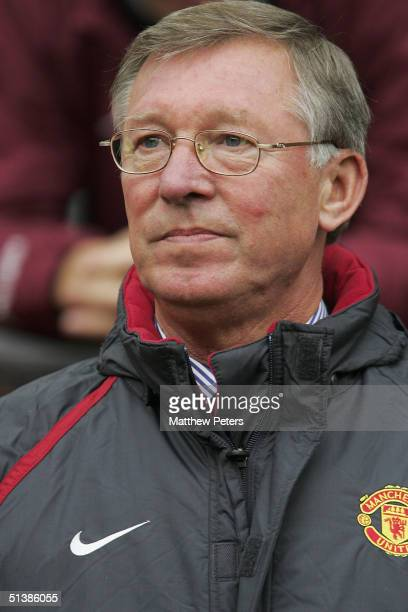 Sir Alex Ferguson of Manchester United watches from the dugout during the Barclays Premiership match between Manchester United and Middlesbrough at...