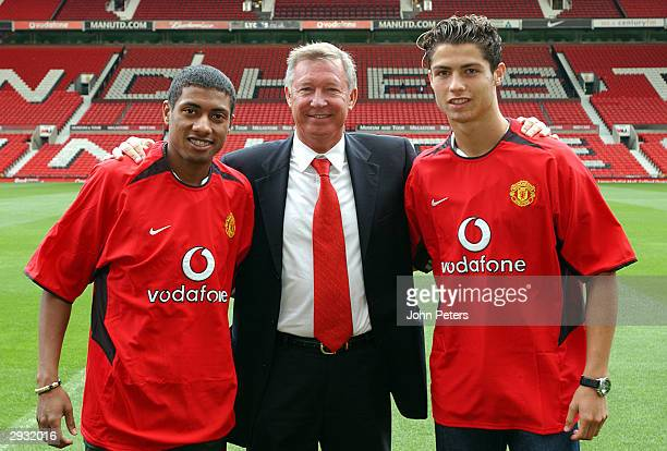Sir Alex Ferguson poses with Kleberson and Cristiano Ronaldo for photographers at Old Trafford on August 13 2003 in Manchester England