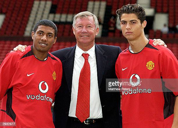 Sir Alex Ferguson poses with Kleberson and Cristiano Ronaldo for photographers on the pitch at the players official signing at Old Trafford on August...