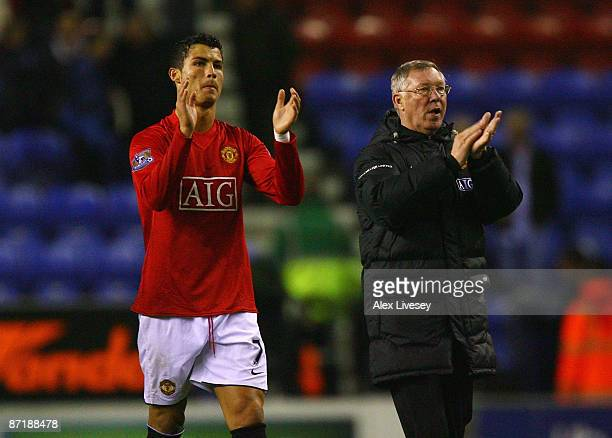 Sir Alex Ferguson the manager of Manchester United and Cristiano Ronaldo celebrate after the Barclays Premier League match between Wigan Athletic and...