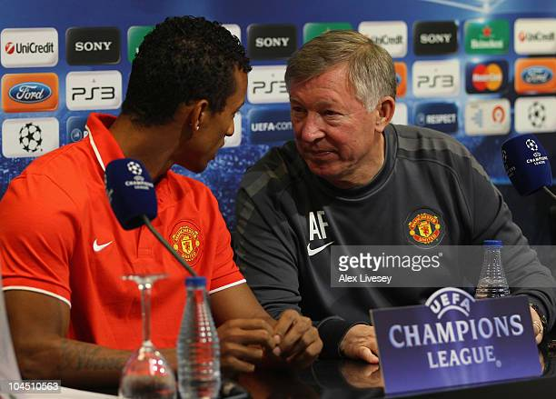 Sir Alex Ferguson the manager of Manchester United and Nani talk while facing the media during a press conference ahead of their Champions League...