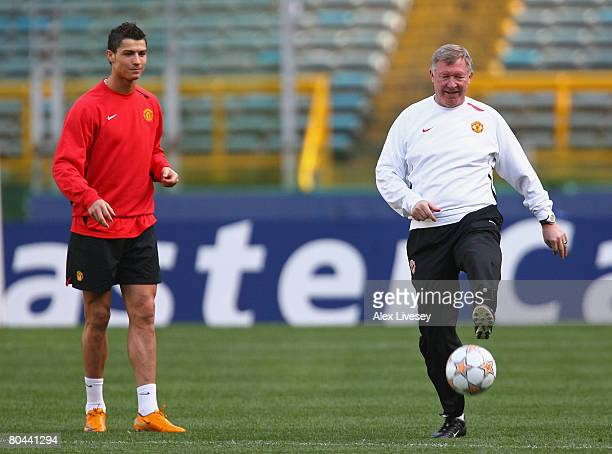 Sir Alex Ferguson the manager of Manchester United controls the ball as Cristiano Ronaldo looks on during the Manchester United training session held...