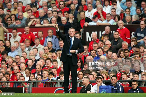 Sir Alex Ferguson the manager of Manchester United directs his team during the Premier League match between Manchester United and Blackburn Rovers at...