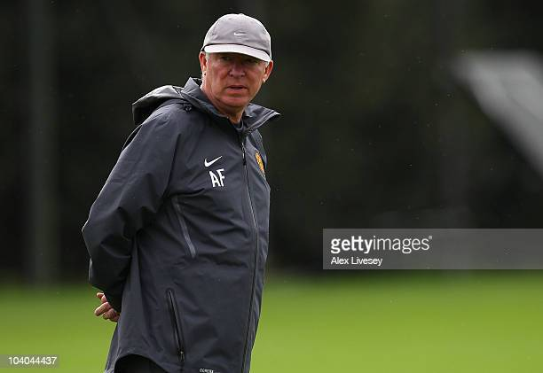 Sir Alex Ferguson the manager of Manchester United looks on during a training session ahead of their UEFA Champions League group match against...
