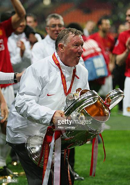 Sir Alex Ferguson the Manchester United manager holds the trophy after the UEFA Champions League Final match between Manchester United and Chelsea at...