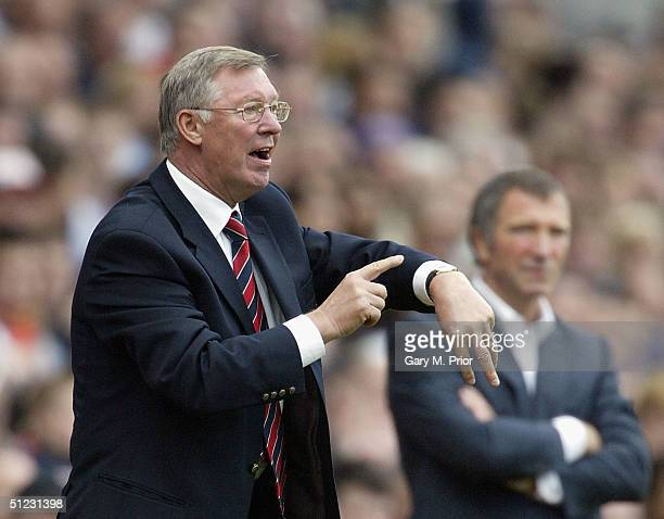 Sir Alex Ferguson the Manchester United manager tells the referee to check his watch during the FA Barclays Premiership match between Blackburn...