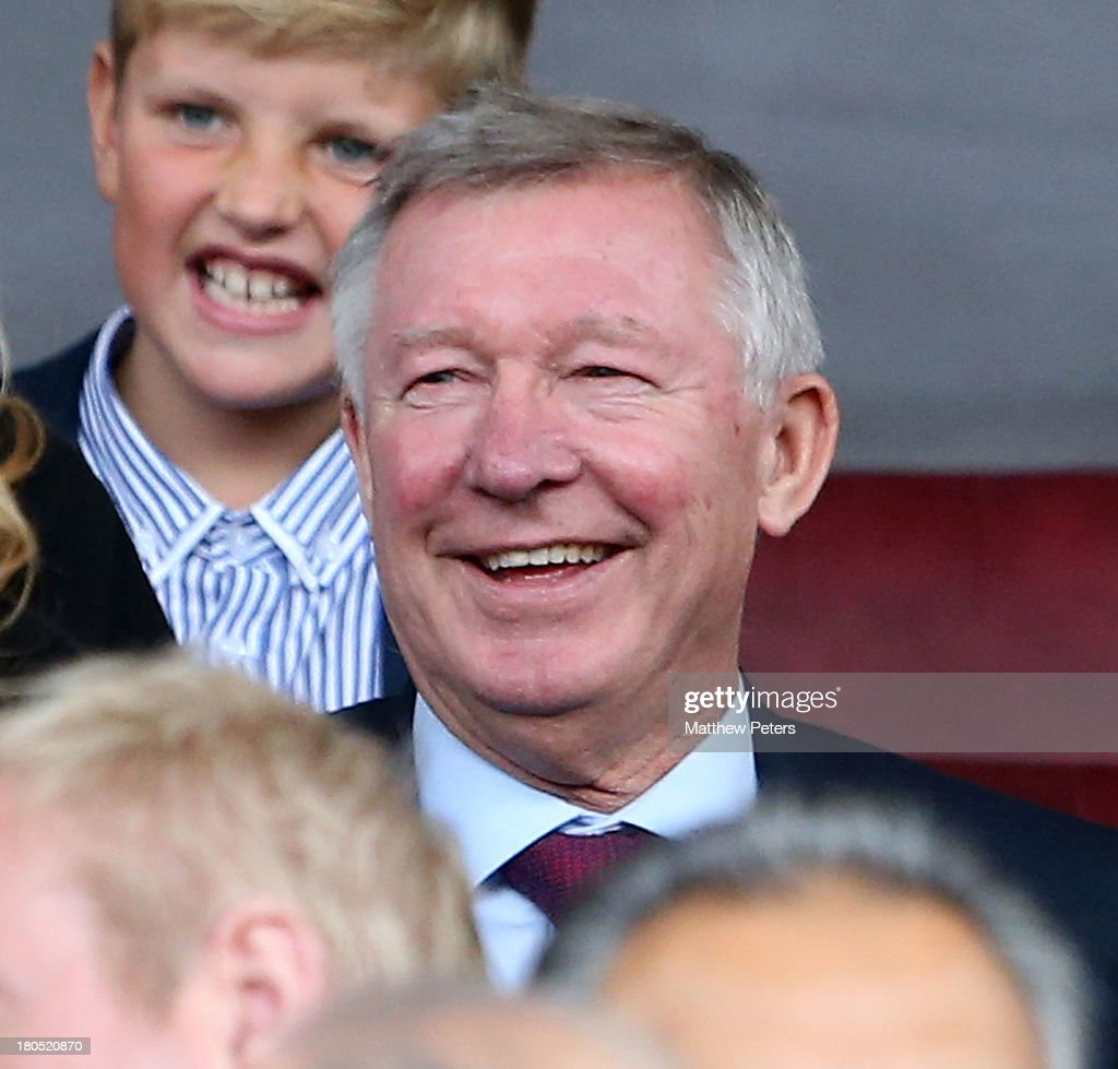 Sir Alex Ferguson watches from the directors' box during the Barclays premier league match between Manchester United and Crystal Palace at Old Trafford on September 14, 2013 in Manchester, England.