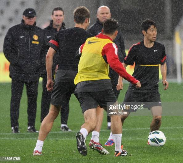 Sir Alex Ferguson watches Shinji Kagawa of Manchester United in action during a first team training session as part of their preseason tour of South...