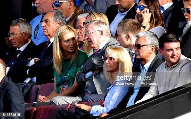 Sir Alex Ferguson with Rachel Riley in the stands during the legends match at Old Trafford Manchester