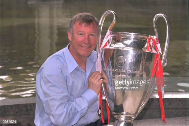 Sir Alex Ferguson with the European Cup the morning after the victory in the UEFA Champions League Final between Bayern Munich v Manchester United at...