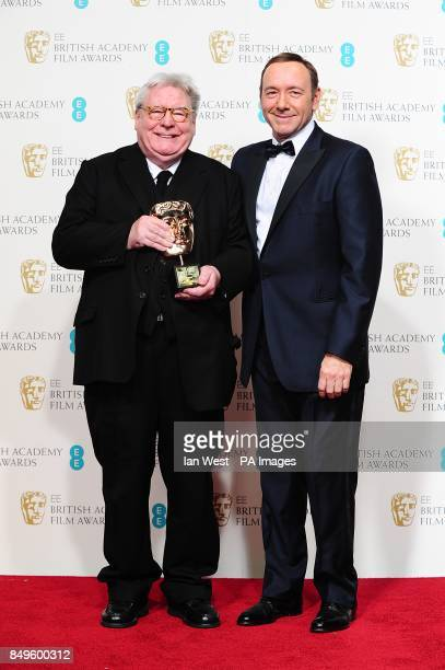 Sir Allan Parker and Kevin Spacey in the press room at the 2013 British Academy Film Awards at the Royal Opera House Bow Street London