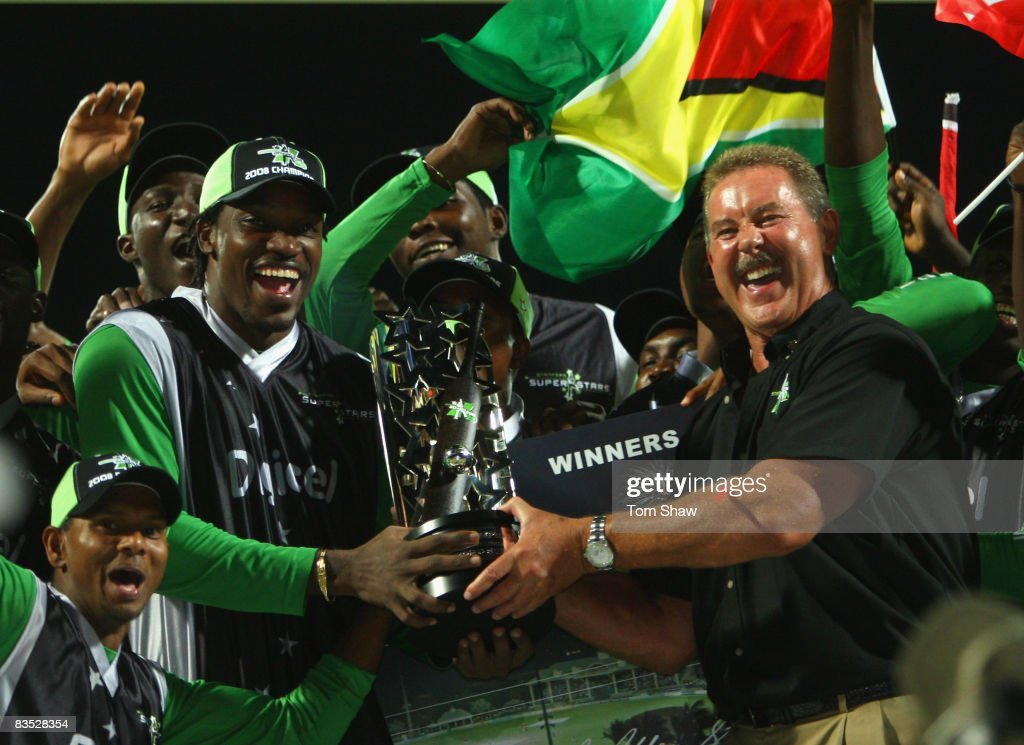 Sir Allen Stanford presents the trophy to Superstars captain Chris Gayle during the Stanford Twenty20 Super Series 20/20 for 20 match between Stamford Superstars and England at the Stanford Cricket Ground on November 1, 2008 in St Johns, Antigua.
