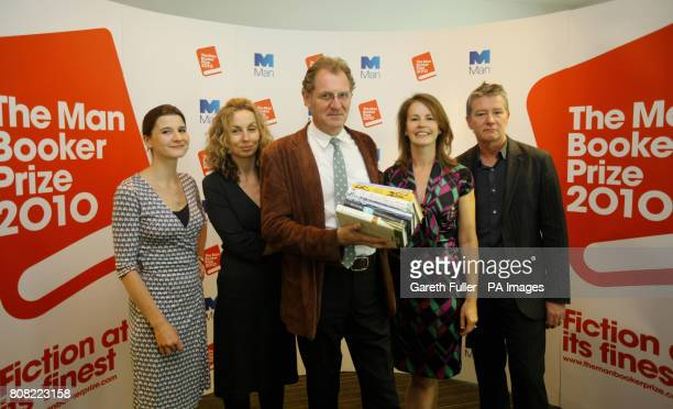 Sir Andrew Motion holds copies of the books shortlisted for the Man Booker Prize with fellow judges Rosie Blau Literary Editor of the Financial Times...