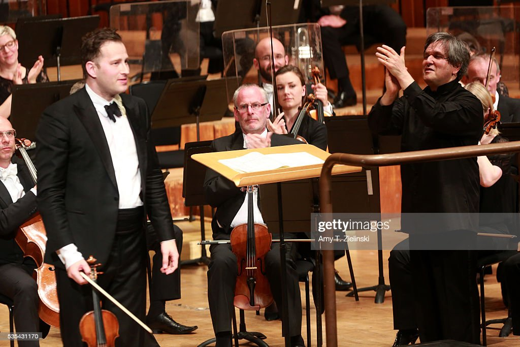 Sir Antonio Pappano claps for soloist violinist Nikolaj Znaider after conducting the London Symphony Orchestra and him in the Beethoven Violin Concerto at Barbican Centre on May 29, 2016 in London, England.
