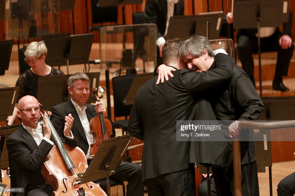Sir Antonio Pappano embraces soloist violinist Nikolaj Znaider after conducting the London Symphony Orchestra and him in the Beethoven Violin Concerto at Barbican Centre on May 29, 2016 in London, England.