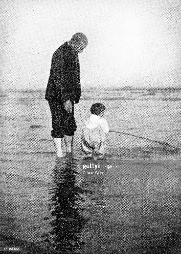Sir <a gi-track='captionPersonalityLinkClicked' href=/galleries/search?phrase=Arthur+Conan+Doyle&family=editorial&specificpeople=203200 ng-click='$event.stopPropagation()'>Arthur Conan Doyle</a> photographed on the Bournemouth coast with his youngest son, Adrian. Paddling in the sea. Scottish author and creator of Sherlock Holmes, 22 May 1859 – 7 July 1930.