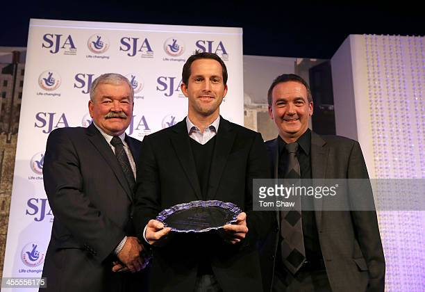 Sir Ben Ainslie receives the Lottery Spirit of Sport Award from Rod Carr and Andy Duncan of the National Lottery during the SJA British Sports Awards...