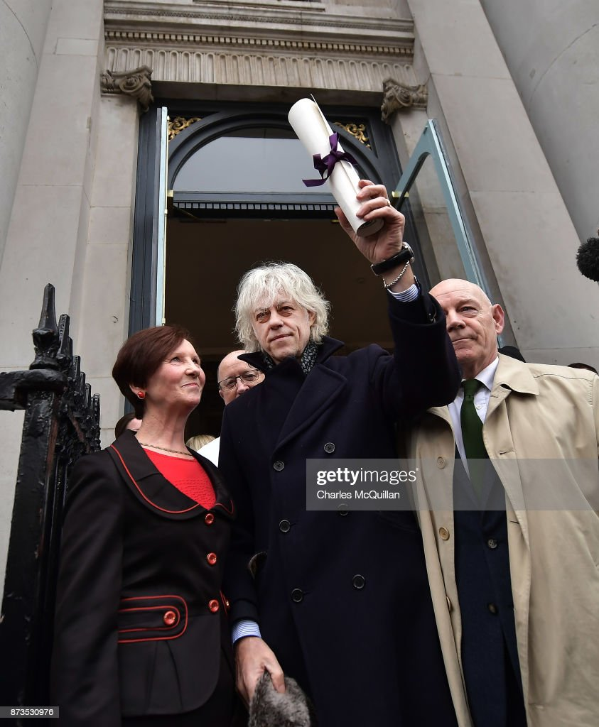 Sir Bob Geldof hands back his freedom of Dublin city to Onnagh Casey, Dublin City Manager's Office at Dublin City Hall on November 13, 2017 in Dublin, Ireland. The Live Aid founder and musician was handing back his freedom of the city in protest against Aung San Suu Kyi who also holds the freedom of Dublin. In a statement Sir Bob Geldof said 'Her association with our city shames us all and we should have no truck with it'. The Burmese Nobel peace laureate, Aung San Suu Kyi has faced widespread criticism over her country's treatment of its Rohingya Muslim minority.
