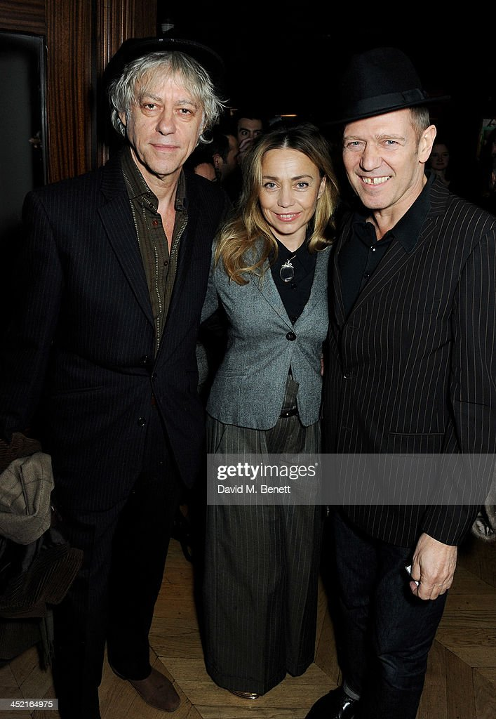 <a gi-track='captionPersonalityLinkClicked' href=/galleries/search?phrase=Sir+Bob+Geldof&family=editorial&specificpeople=204423 ng-click='$event.stopPropagation()'>Sir Bob Geldof</a>, <a gi-track='captionPersonalityLinkClicked' href=/galleries/search?phrase=Jeanne+Marine&family=editorial&specificpeople=159392 ng-click='$event.stopPropagation()'>Jeanne Marine</a> and <a gi-track='captionPersonalityLinkClicked' href=/galleries/search?phrase=Paul+Simonon&family=editorial&specificpeople=216507 ng-click='$event.stopPropagation()'>Paul Simonon</a> attend the Project Zoltar 10th anniversary celebration and launch of Zoltar the Magnificent at The Groucho Club on November 26, 2013 in London, United Kingdom.