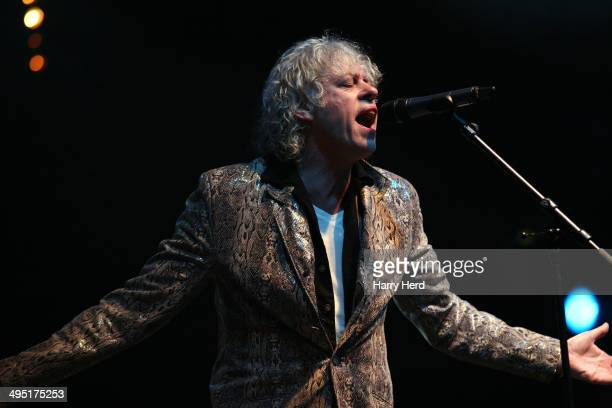 Sir Bob Geldof of The Boomtown Rats performs on stage at Wychwood Festival at Cheltenham Racecourse on June 1 2014 in Cheltenham United Kingdom