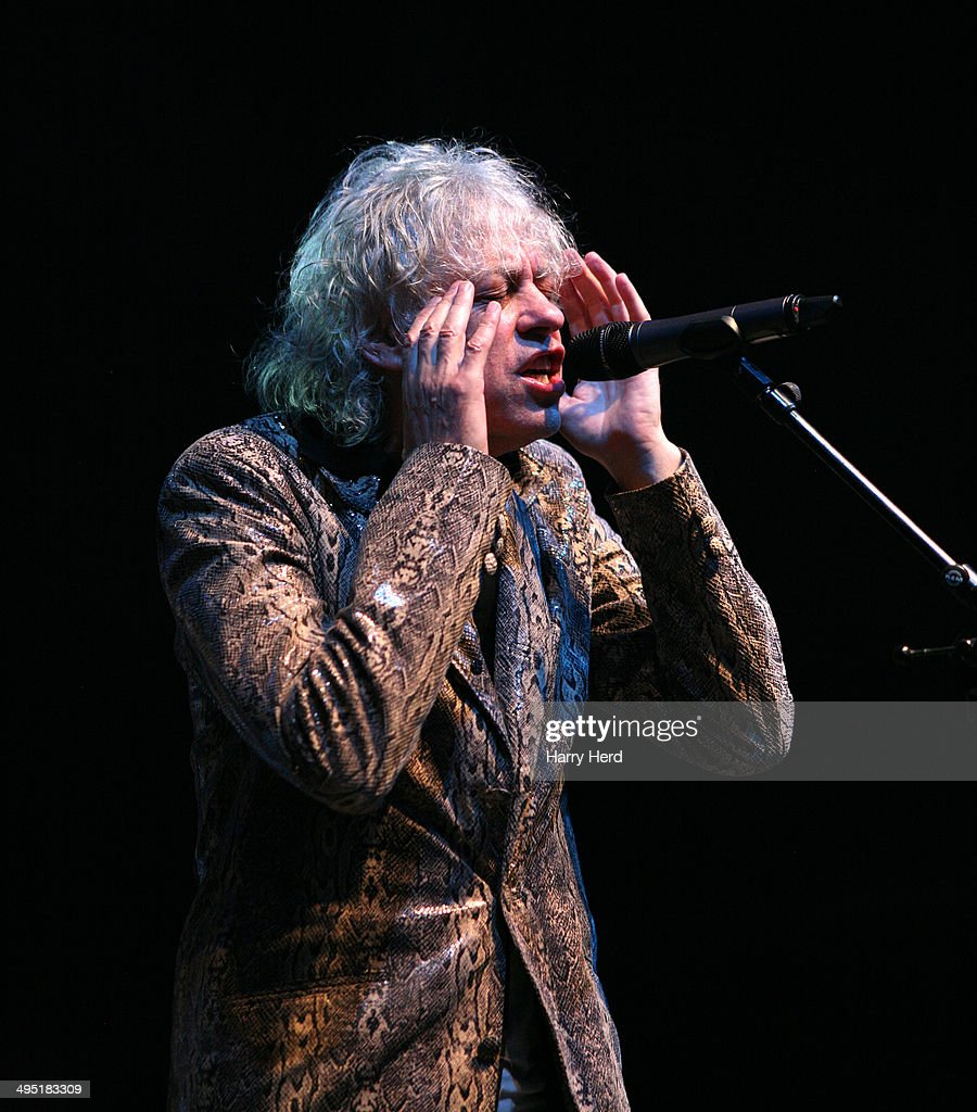 <a gi-track='captionPersonalityLinkClicked' href=/galleries/search?phrase=Sir+Bob+Geldof&family=editorial&specificpeople=204423 ng-click='$event.stopPropagation()'>Sir Bob Geldof</a> of The Boomtown Rats performs on stage at Wychwood Festival at Cheltenham Racecourse on June 1, 2014 in Cheltenham, United Kingdom.