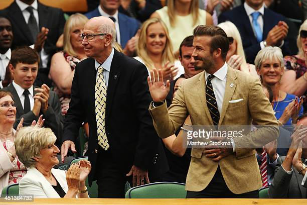 Sir Bobby Charlton and David Beckham in the royal box on centre court on day six of the Wimbledon Lawn Tennis Championships at the All England Lawn...