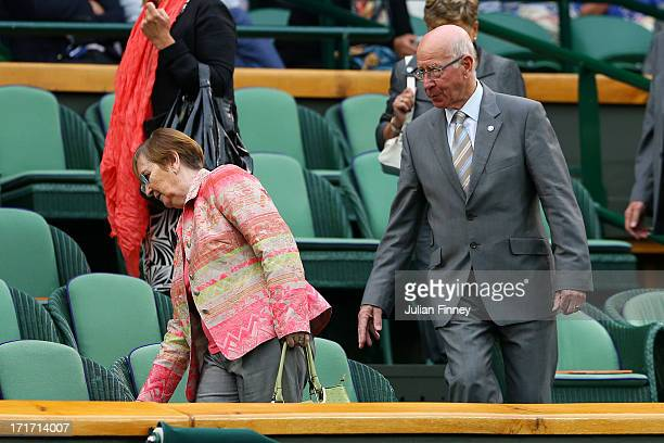 Sir Bobby Charlton and his wife Norma take their seats in the Royal Box in Centre Court on day five of the Wimbledon Lawn Tennis Championships at the...