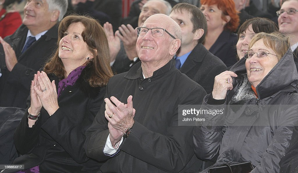 Sir Bobby Charlton (C) attends the unveiling of a statue of Manager Sir Alex Ferguson of Manchester United at Old Trafford on November 23, 2012 in Manchester, England.