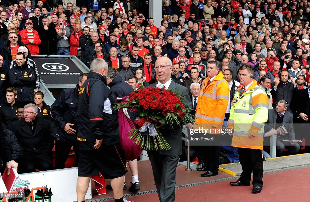 Sir Bobby Charlton brings out flowers in honour of the Hillsborough tragedy before the Barclays Premier League match between Liverpool and Manchester United at Anfield on September 23, 2012 in Liverpool, England.