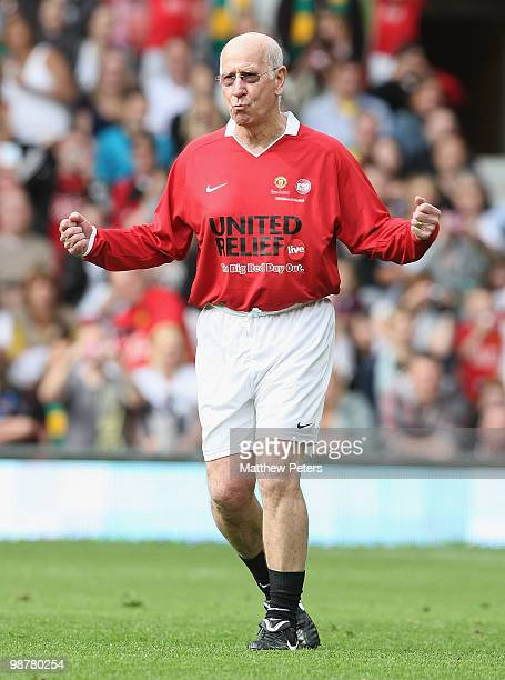Sir Bobby Charlton celebrates scoring a penalty kick at halftime during the United Relief charity match in aid of Sport Relief and the Manchester...