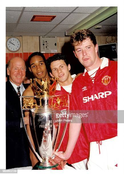 Sir Bobby Charlton Gary Pallister Ryan Giggs and Paul Ince celebrate with the Premiership Trophy in the dressing room after the FA Carling...
