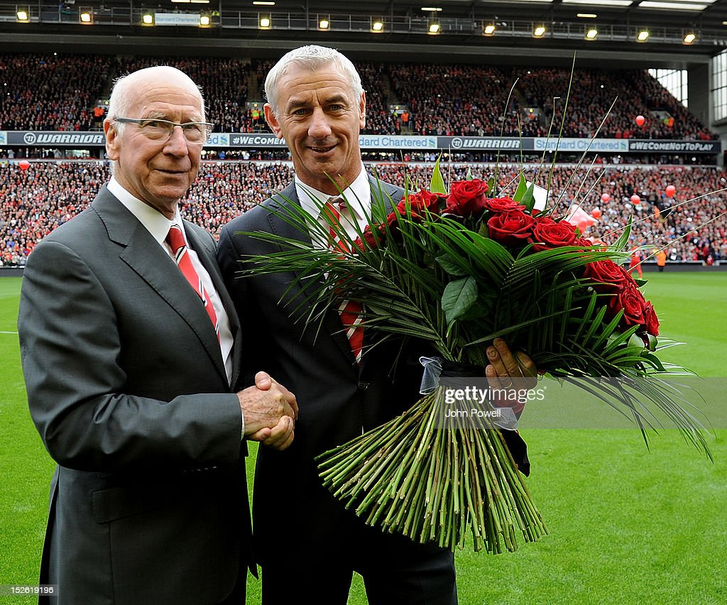 Sir Bobby Charlton hands flowers to Ian Rush in honour of the Hillsborough tragedy before the Barclays Premier League match between Liverpool and Manchester United at Anfield on September 23, 2012 in Liverpool, England.