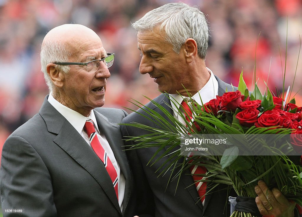 Sir Bobby Charlton of Manchester United presents a bouquet of flowers to Ian Rush of Liverpool in memory of the 96 Liverpool fans killed in the Hillsborough disaster in 1989 ahead of the Barclays Premier League match between Liverpool and Manchester United at Anfield on September 23, 2012 in Liverpool, England.