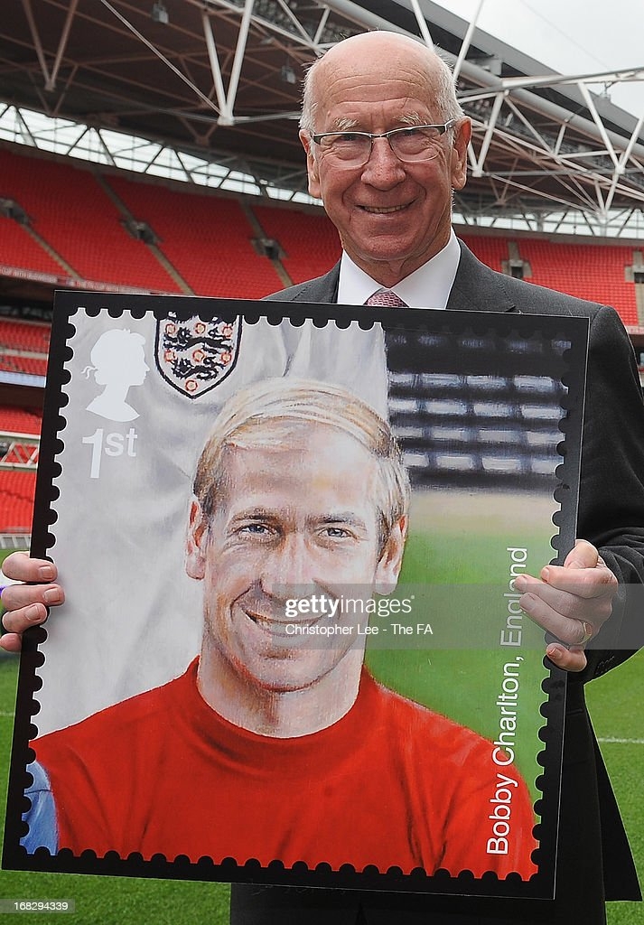 Sir <a gi-track='captionPersonalityLinkClicked' href=/galleries/search?phrase=Bobby+Charlton&family=editorial&specificpeople=204207 ng-click='$event.stopPropagation()'>Bobby Charlton</a> poses for the camera with his stamp during the Royal Mail Stamp Launch at Wembley Stadium on May 8, 2013 in London, England.