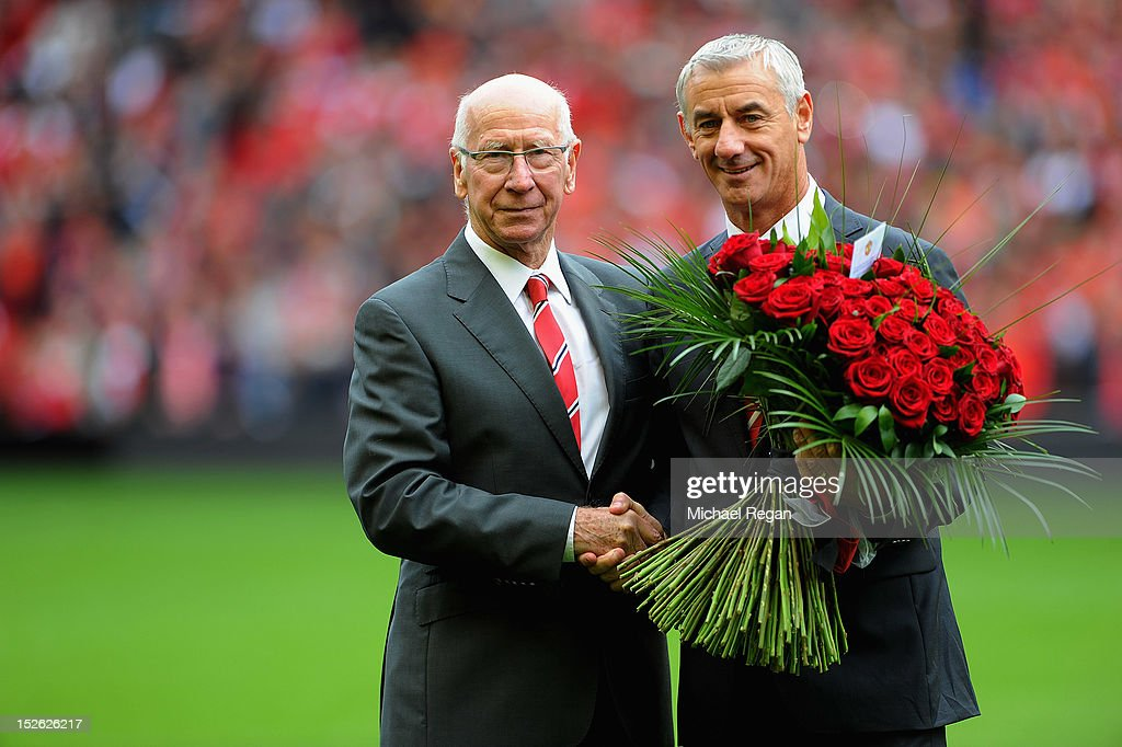 Sir Bobby Charlton presents Ian Rush with flowers before the Barclays Premier League match between Liverpool and Manchester United at Anfield on September 23, 2012 in Liverpool, England.