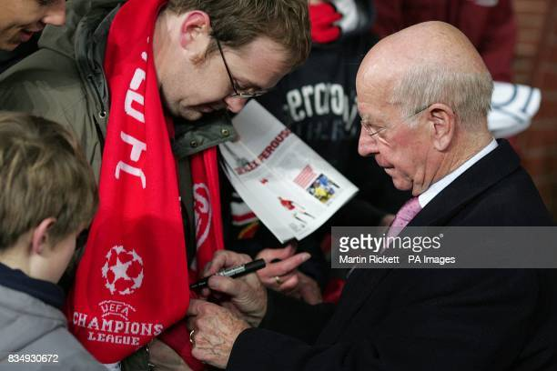 Sir Bobby Charlton signs autographs before kick off