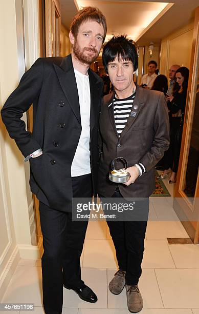 Sir Bradley Wiggins and Johnny Marr winner of the Gibson Les Paul award pose in the press room at the Xperia Access Q Awards at The Grosvenor House...
