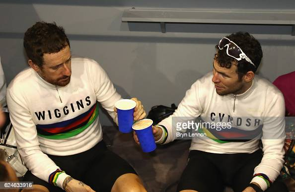 Sir Bradley Wiggins and Mark Cavendish of Great Britain and Team John Saey Callant celebrate victory with a drink after the final day of the 76th 6...