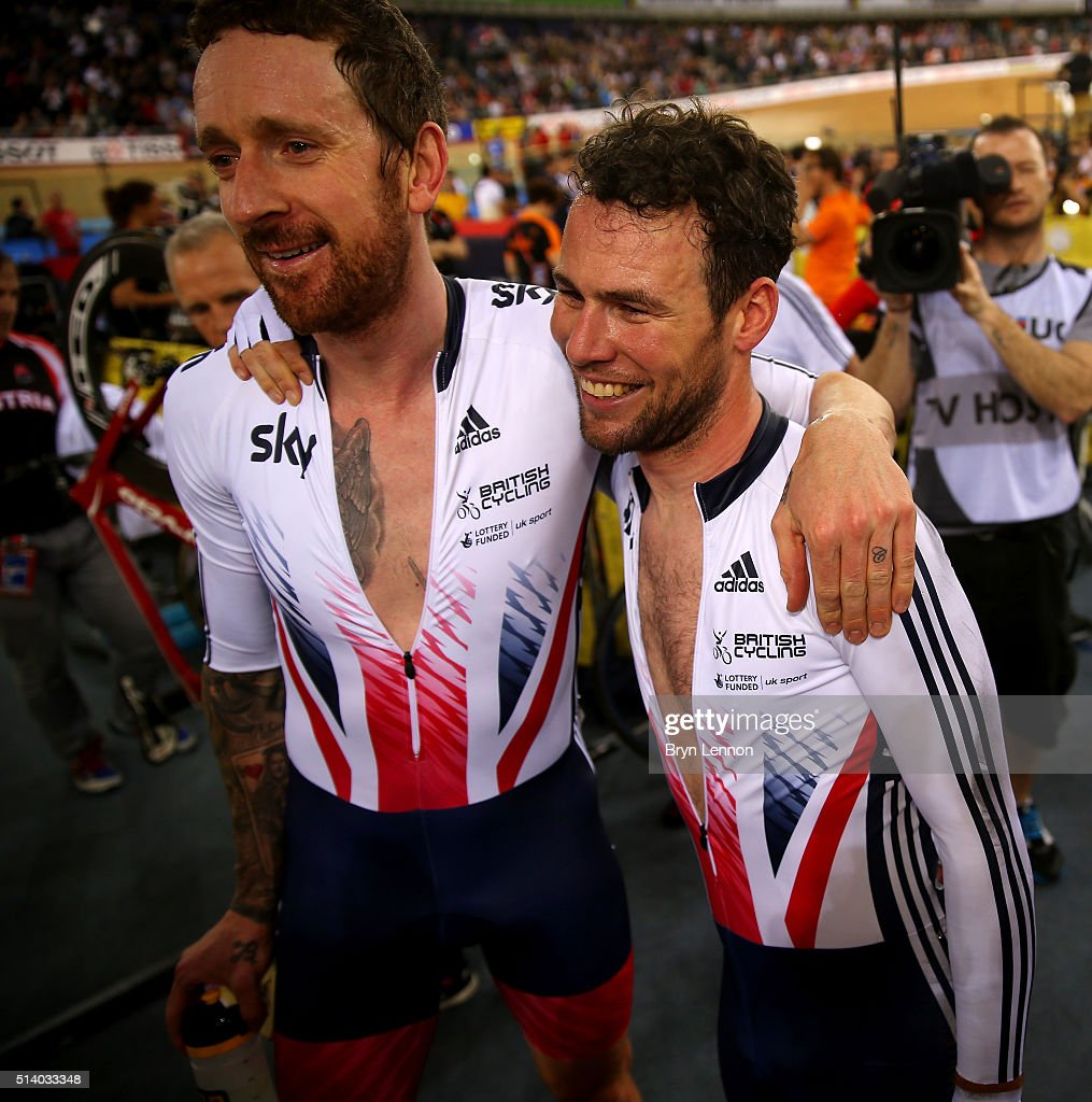 Sir Bradley Wiggins and Mark Cavendish of Great Britain embrace after winning the Men's Madison Final during Day Five of the UCI Track Cycling World...